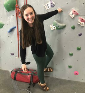 Photo of woman at climbing wall